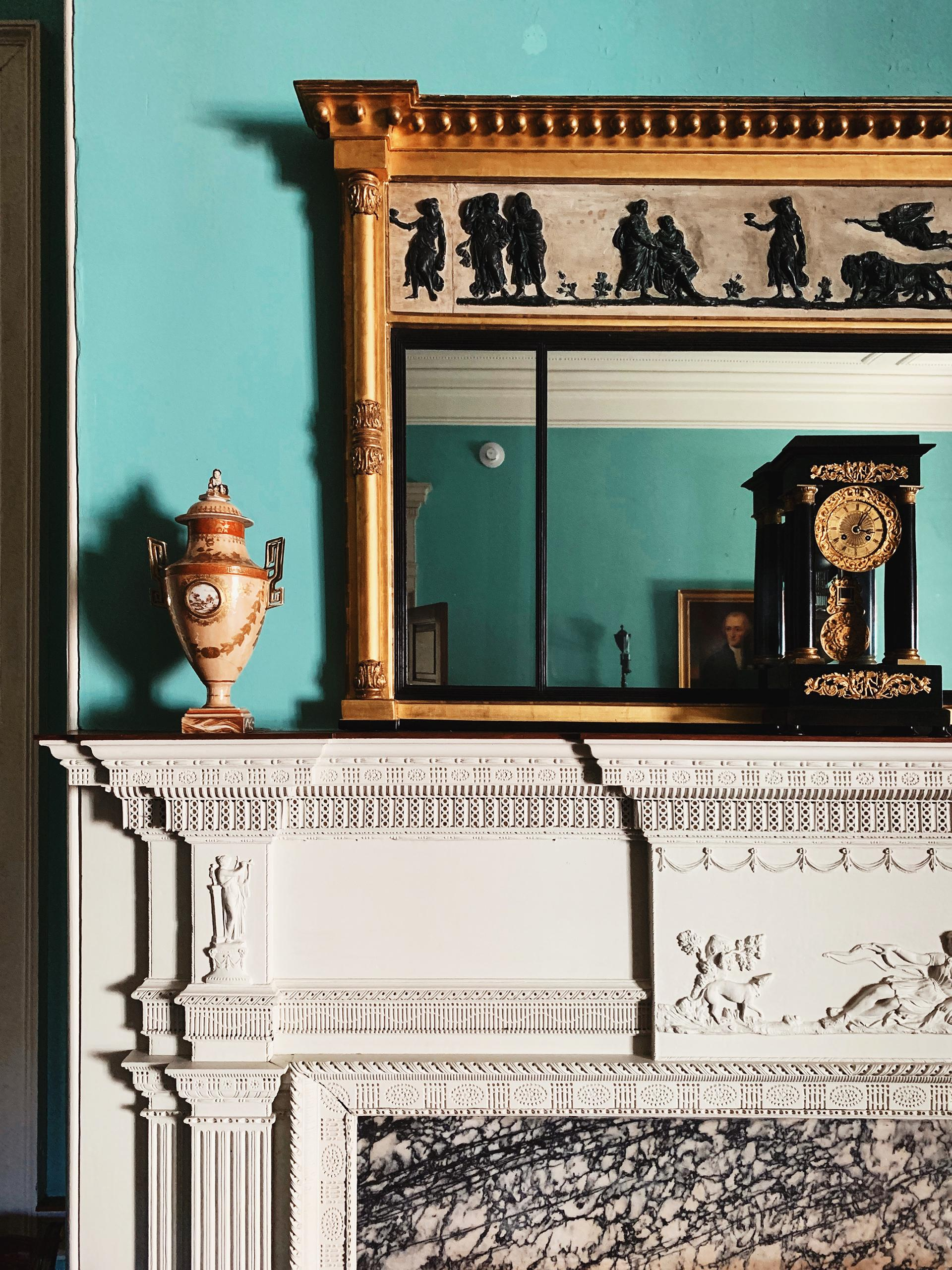 Composite Ornamentation on the fireplace mantel with a looking glass above