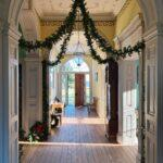 front hall decorated for holidays looking at the open door