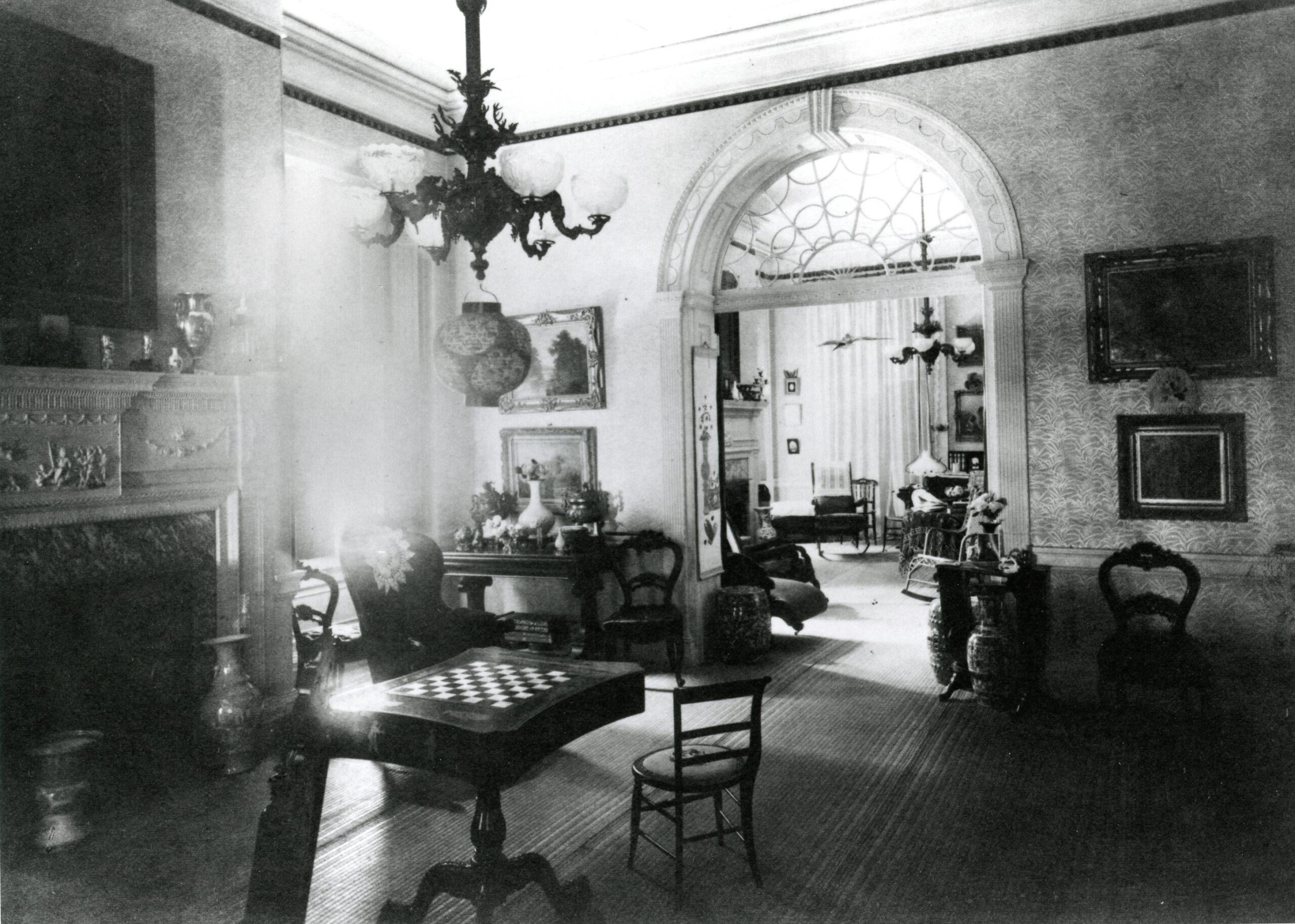 a balck-and-white photo of the interior of a house
