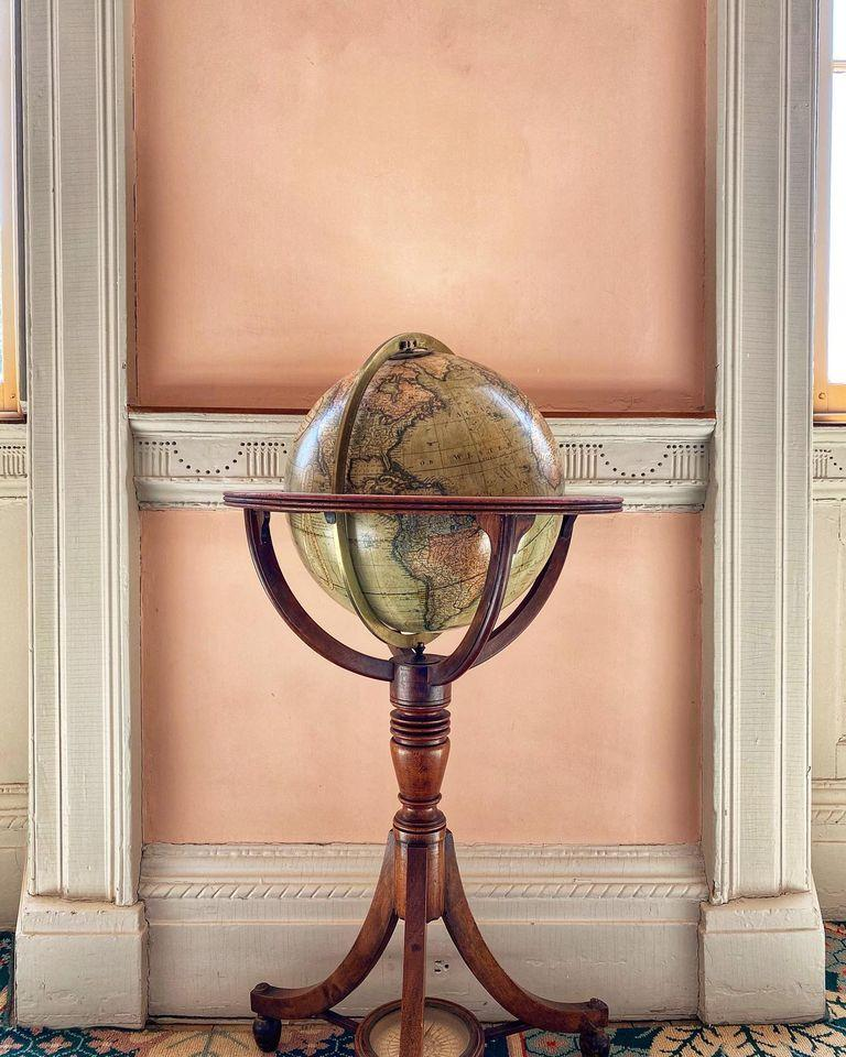Terrestrial globe against a wall and between two windows