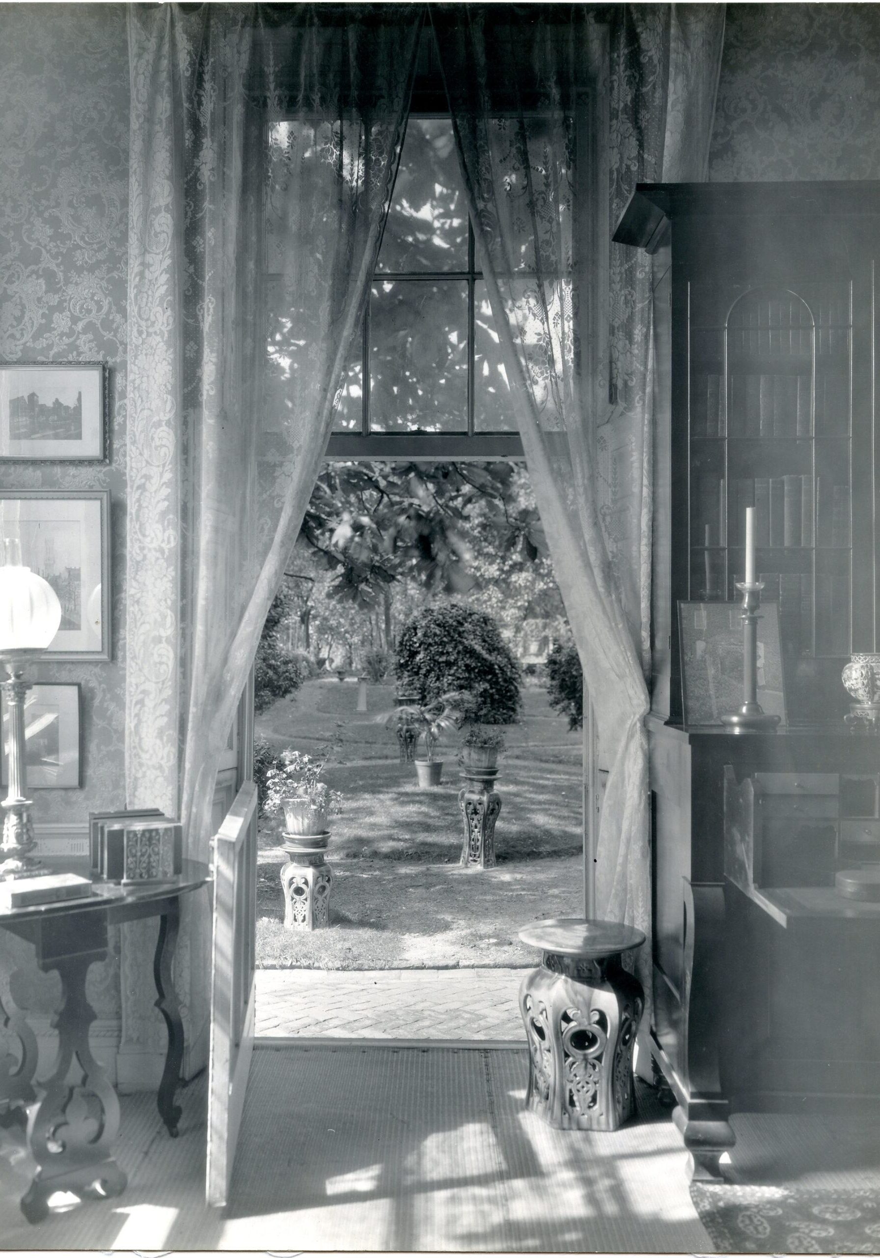 black-and-white historic photograph of an open window